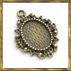 Antikolt bronz színű, Tibeti stílusú ovális kis medál kaboson foglalat 10x14 mm NIKKELMENTES