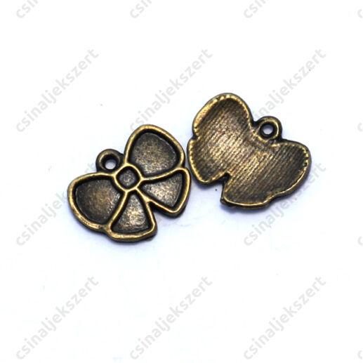 Antikolt bronz színű masni alakú medál