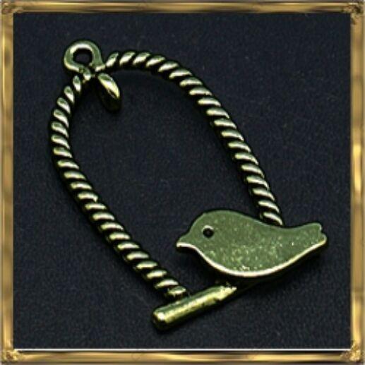 Antikolt bronz madárkás hinta medál
