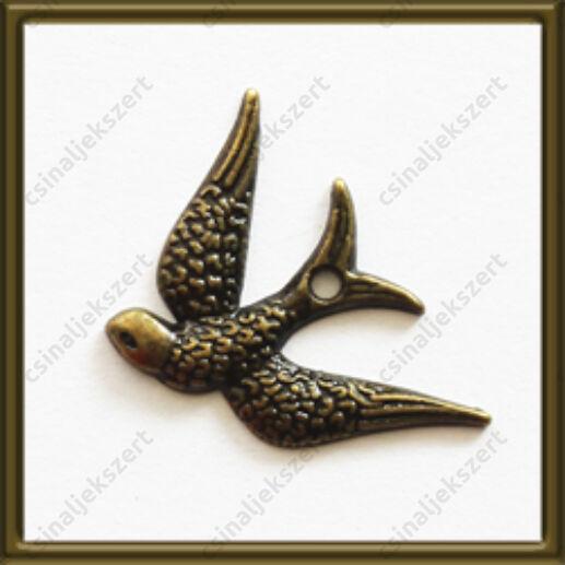 Antikolt bronz színű lefele repülő fecske függő dísz