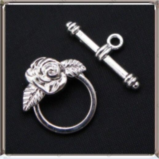 Antikolt ezüst színű rózsás T kapocs