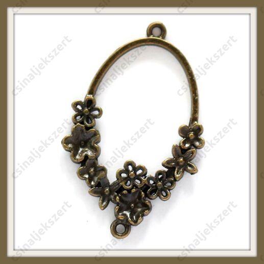 Antikolt bronz színű ovális, virágokkal díszített kapcsoló elem, függő dísz