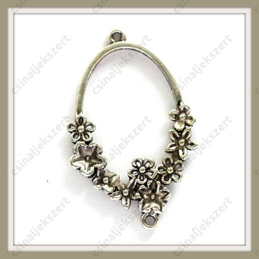 Antikolt ezüst színű ovális, virágokkal díszített kapcsoló elem