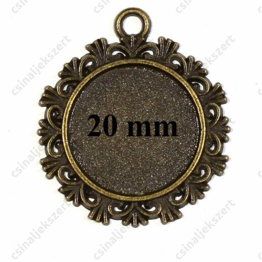 Antikolt bronz színű cakkos szélű üveglencsés medál alap 20 mm