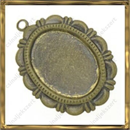 Antikolt bronz színű, réz ovális díszes medál 13x18 mm