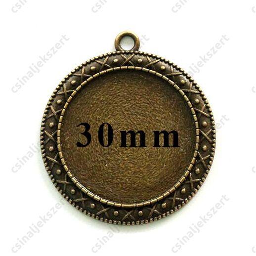 Antikolt bronz színű, díszes szélű kerek medál 30 mm